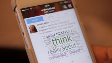 Andrea Shaw's Twitter account showing on a phone screen