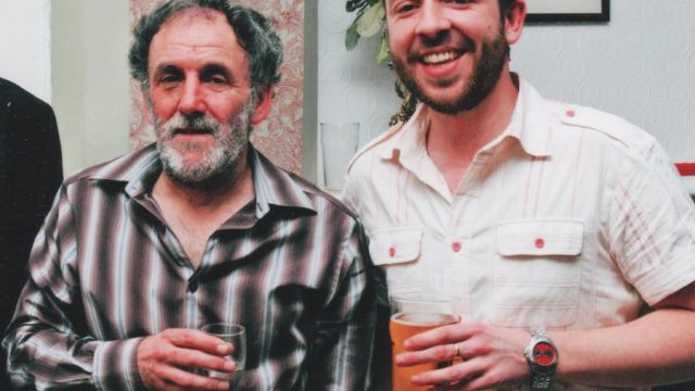 John and his dad, with pints in their hands