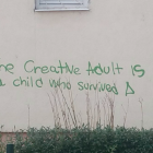 Graffiti saying 'the creative adult is a child who survived'