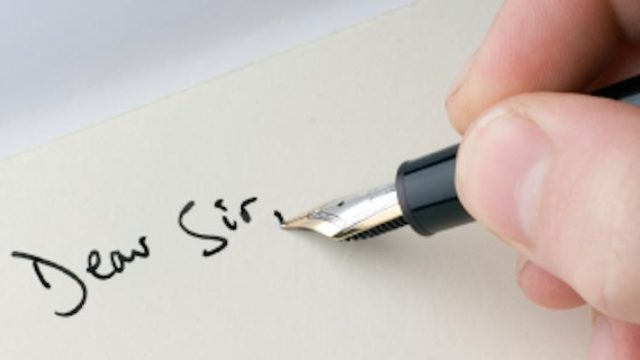 A pen writing on paper