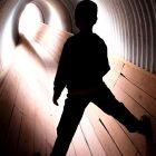 A boy in a tunnel