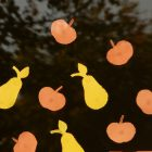 poem: photo of cut out paper apples and pears