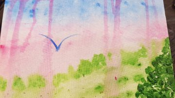 purple: beautiful watercolour of a bird flying high in a purpley sky over trees and fields