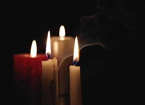 candles burning in the darkness