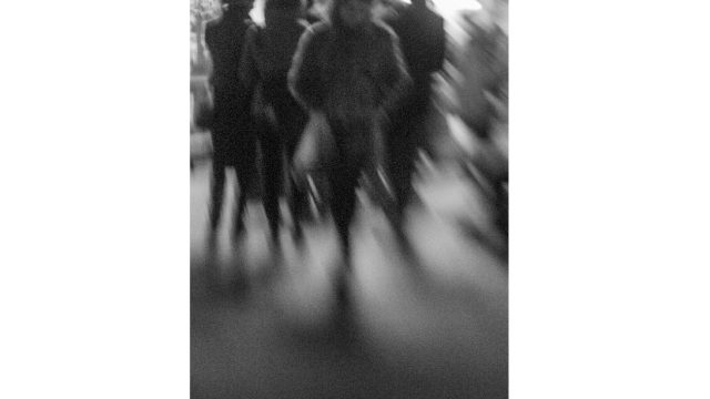 blurred image of people moving