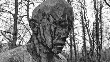 wooden sculpture of a man