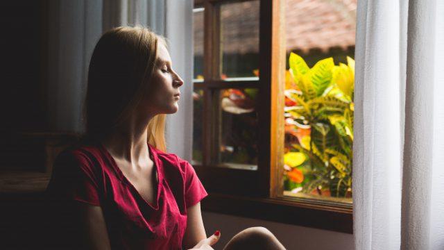 woman sat by a window