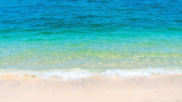 waves landing on a beach
