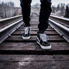 feet walking along a rail track