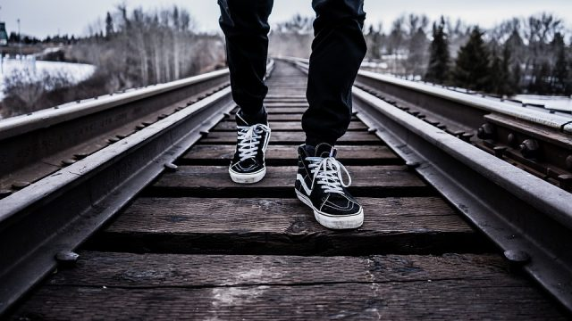 feet walking along a rail track