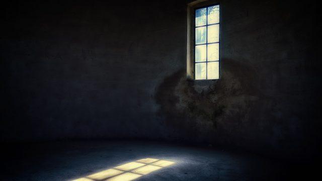 light shining through the window into a dark room