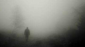 Silhouette of a figure in the fog