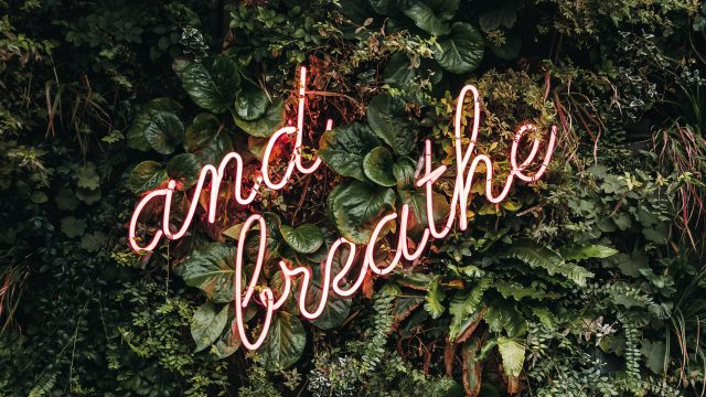 lit up text saying 'and breathe'