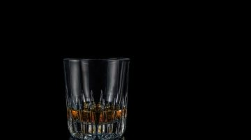 Sobriety and mindful meditation image of glass of spirits