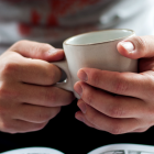 hands with mug