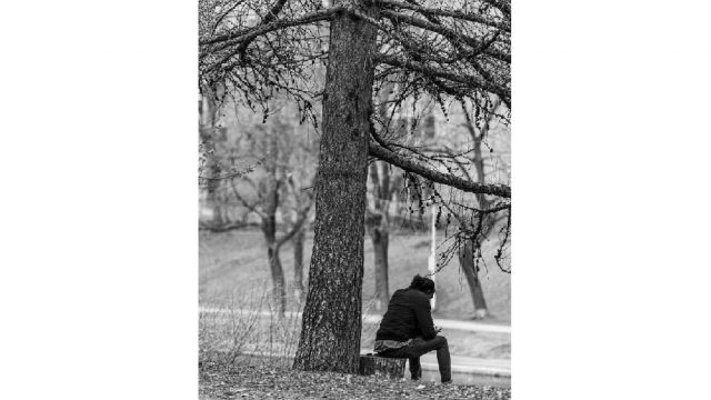 Man sitting alone in a park